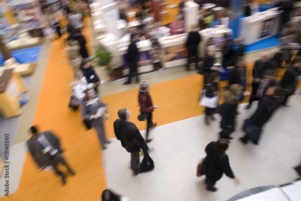 Fototapeta Visitors passing by stands at exhibition