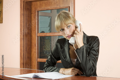 blond receptionist at phone