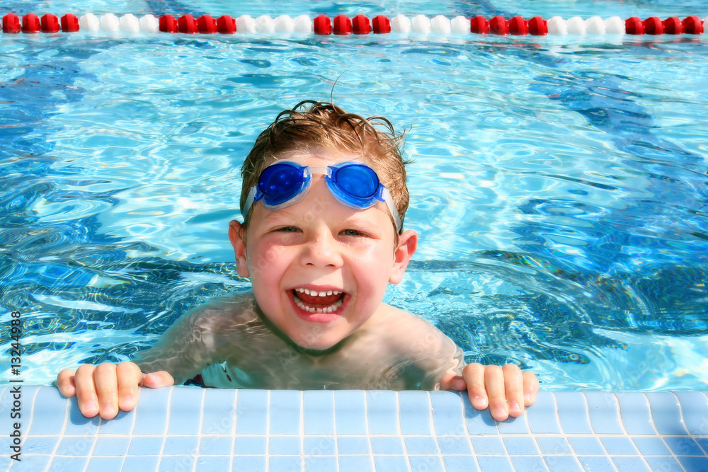 Fototapety, obrazy: Happy child in a swimming pool