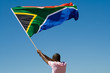 canvas print picture - african man waving a south african flag