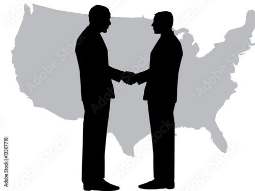Fotografie, Obraz  A silhouette of men handshaking with map of USA