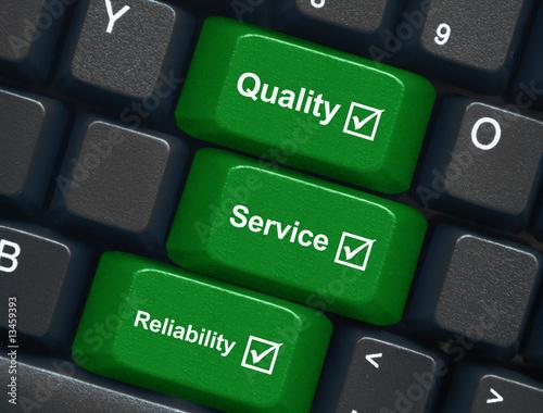 "Láminas  ""Quality, Service & Reliability"" keys on keyboard"
