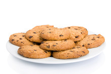 Pile Of Chocolate Chip Cookies On A Dish Isolated