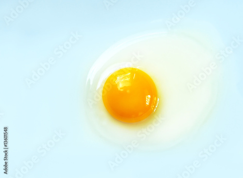 Deurstickers Gebakken Eieren Raw Egg on Blue Background