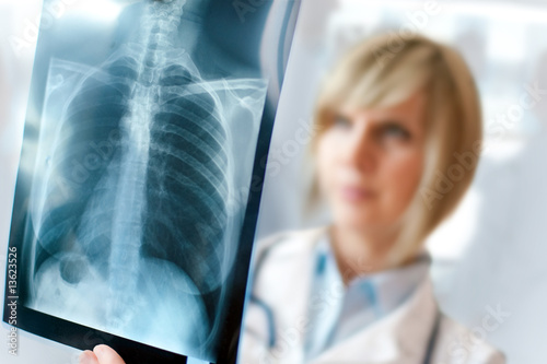 Fotografie, Obraz  Female doctor examining an x-ray