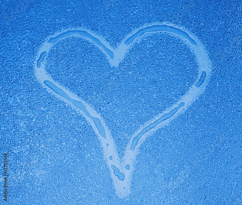 Photo Stands Personal Heart sign on wet glass in blue tone