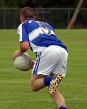 Gaelic Footballer Running