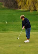 Senior Woman Putting On The Gr...