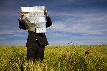 Businessman Lost In Field Usin...