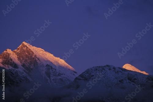 Fototapeta Mountain peaks at sunset obraz na płótnie