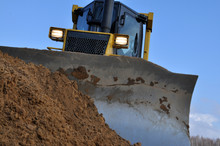 Bulldozer Is Pushing Soil In A Worksite