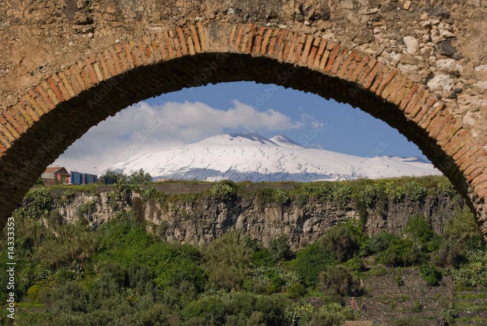 Fényképezés  view  of volcano Etna framed by blurred arch