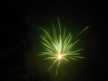 Green Fireworks In A Dark Sky