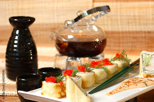Fototapeta sushi with chinese tea