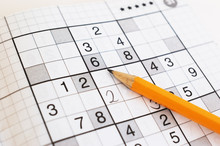Close Up Of Sudoku Game And Ye...