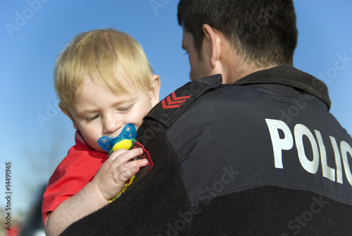Canvas Police Officer Holds baby