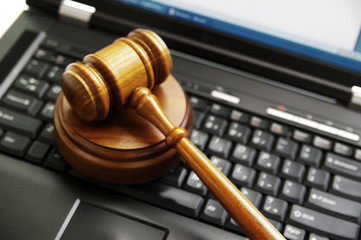 Fototapeta judges gavel on a laptop computer (cyber law)