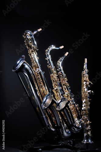 Four Saxophones on black Wallpaper Mural