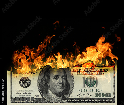 Fototapeta  Burning dollars close up over black background