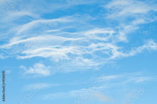 wispy cloud group on blue sky Fototapeta