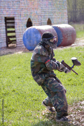 Photo  paintball gamers, solder, on the run in attack attempt