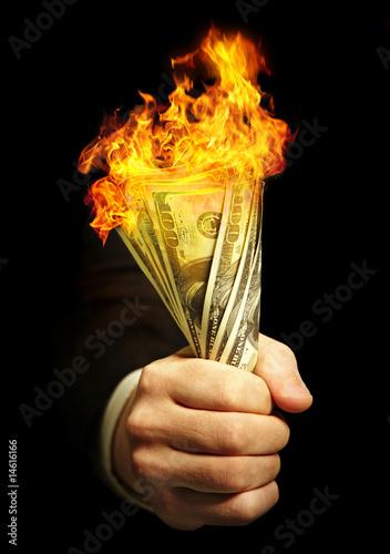Fototapeta man's hand holds dollars