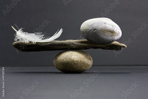 Photo feather and stone balance