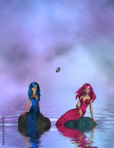 Foto op Canvas Zeemeermin PINK AND BLUE MERMAIDS SITTING ON ROCKS