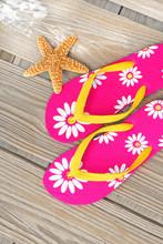 Flip Flops And Starfish On Dock