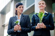 Businesswomen With Plants