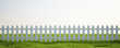 Leinwandbild Motiv White picket fence on grass