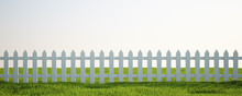 White Picket Fence On Grass