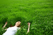 Leinwanddruck Bild - beautiful girl lying down of grass