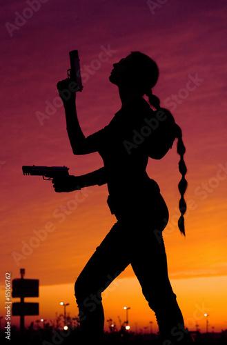 фотография  silhouette of girl with guns