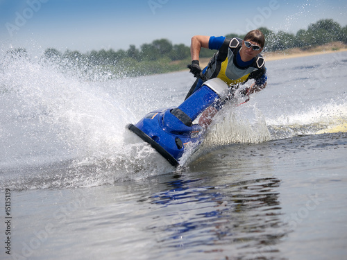 Papiers peints Nautique motorise Man on jet ski skims along camera