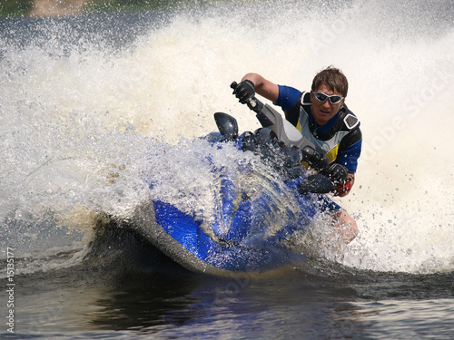 Fotomural Man on jet-ski turns very fast with diving