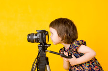 Baby Girl Holding Photo Camera