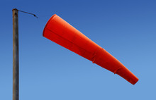Airport Orange Windsock Blowing In The Wind.
