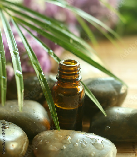 Akustikstoff - Bottle of tropical oil and stones.