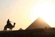 Camel Rider And Pyramids