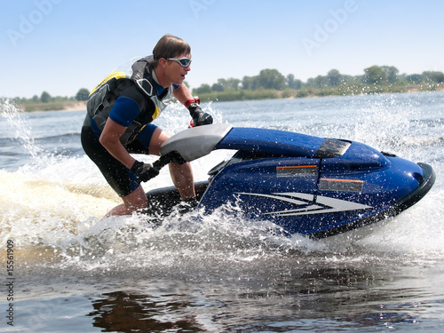 Papiers peints Nautique motorise Man on jet ski rides very close