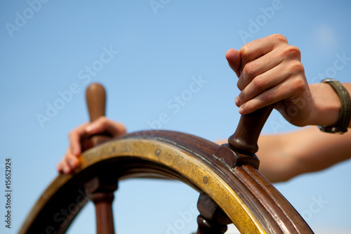 Платно Hands on ship rudder.