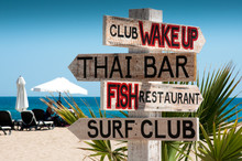 Wooden Signboard From Four Arrows On The Beach