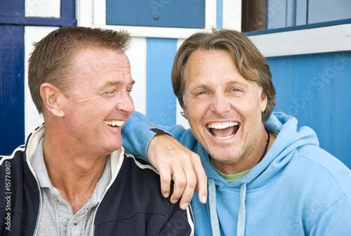 Fotografie, Obraz  Two happy gay men cuddling.