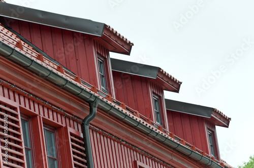 Photo sur Toile Ville sur l eau Mansard with windows and tilled roof