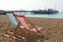 Deckchairs On Brighton Beach And Pier, England
