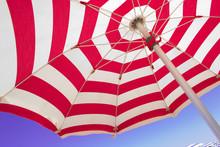 Section Of Beach Umbrella Against Blue Sky.