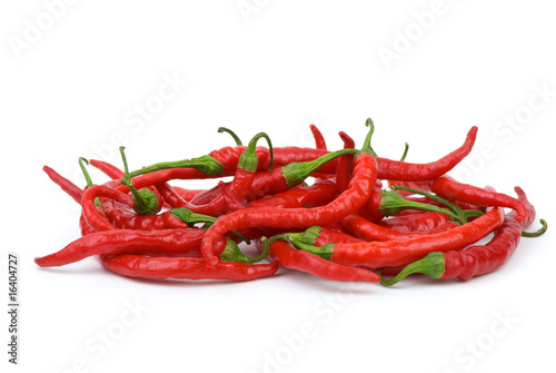 Pile of long curved red hot chili peppers