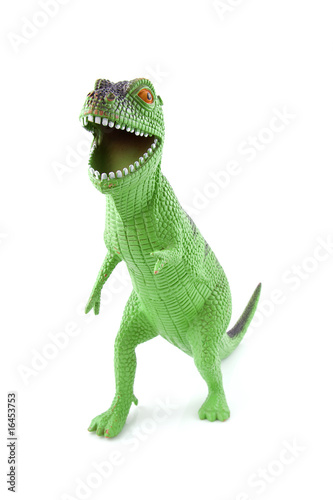 green dinosaur play toy over white background