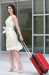 Female with Suitcase Traveling Outdoors